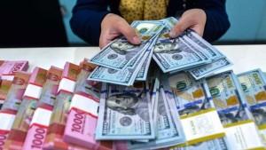 Ilustrasi dolar AS dan Rupiah-1633683435