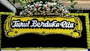 Ilustrasi papan bunga ucapan turut berduka cita-1634471009
